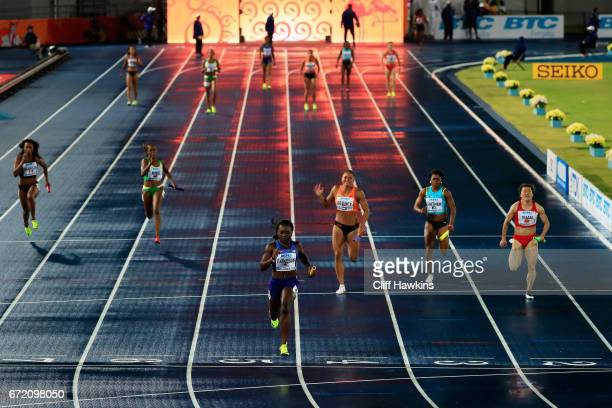 Morolake Akinosun of the USA crosses the finishline in the first heat of the Women's 4x100 Metres Relay during the IAAF/BTC World Relays Bahamas 2017...