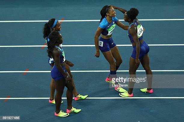 Morolake Akinosun Tianna Bartoletta English Gardner and Allyson Felix of the United States celebrate after the round one Women's 4 x 100m Relay ReRun...