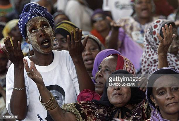 Comoran women pray 11 May 2006 during the closing rally of opposition leader Ahmed Abdallah Sambi in Moroni Comoros Voters in Comoros go to the polls...