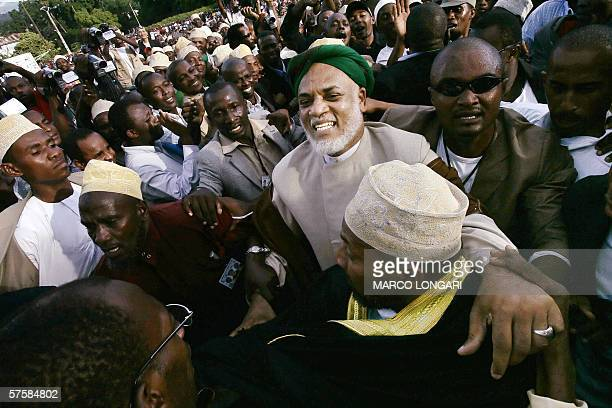 Comorian presidential candidate Ahmed Abdallah Sambi arrives 11 May 2006 at his last political rally in Moroni Comoros before 14 May's presidential...
