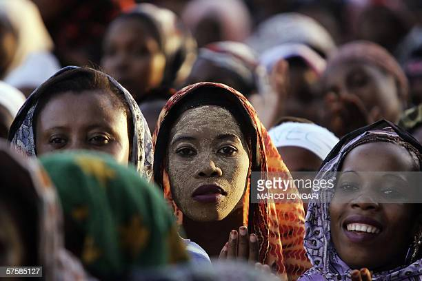 Comorian women pray 11 May 2006 during the closing rally of opposition leader Ahmed Abdallah Sambi in Moroni Comoros Voters in Comoros go to the...