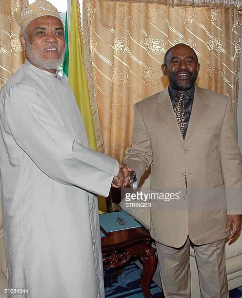Comoros president elect Ahmed Abdallah Sambi shakes hands with former president Azali Assoumani during a brief ceremony in Moroni 26 May 2006 Sambi...