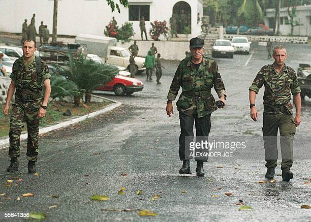 French mercenary leader Bob Denard and other mercenaries FrancoisXavier Sidos and 'Charles' seen walking in Moroni before handing themselves in to...