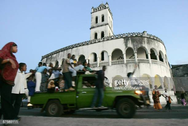Supporters of the opposition leader Ahmed Abdallah Sambi march 11 May 2006 in front of the mosque on the waterfront of Moroni Comoros at the end of...