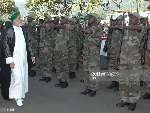 The Head of the Comorian State Mr Ahmed Abdallah Sambi inspects a military parade trained by Southern African 18 May 2007 during the official...