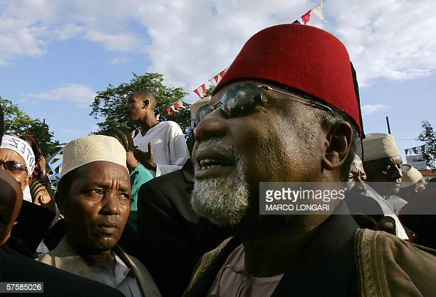 Traditionally dressed Comoran men take part 11 May 2006 in the last rally of opposition leader Ahmed Abdallah Sambi in Moroni Comoros Voters in...