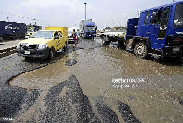 Morotists stuck in jams on waterlogged potholes on Apapa Oshodi expressway that leads to Apapa ports West Africa's busiest and largest container...