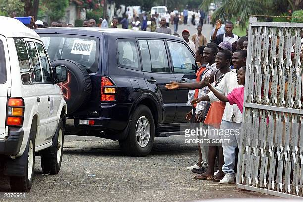 Morovians greet Nigerian General Festus Okonkwo and the ECOWAS advance military delegation convoy arriving in Monrovia 31 July 2003 The delegation is...