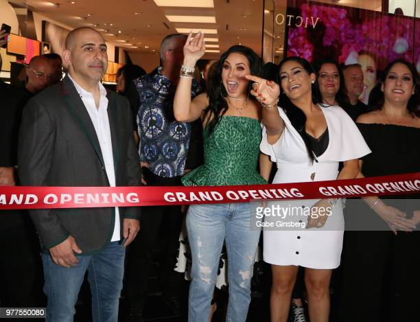 Morphe coowner Chris Tawil YouTube personality Jaclyn Hill and Morphe coowner Linda Tawil prepare to cut a ribbon cutting during Morphe store opening...