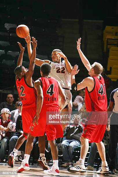 Morris Almond of the Utah Flash passes the ball against Lanny Smith Jamaal Tatum and Lance Allred the Idaho Stampede at McKay Events Center on March...