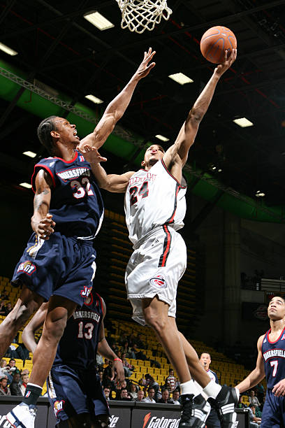 Morris Almond #24 of the Utah Flash puts the shot up over George Williams #32 of the Bakersfield Jam at the David O. McKay Events Center December 22, 2007 in Orem, Utah.