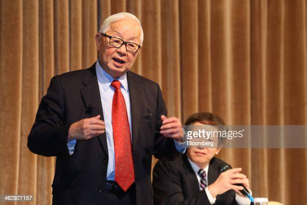 Morris Chang, chairman of Taiwan Semiconductor Manufacturing Co. , left, speaks as Mark Liu, co-chief executive officer and co-president, looks on...