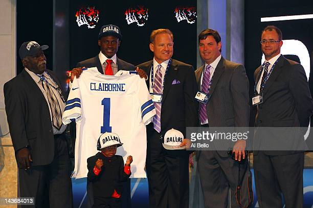 Morris Claiborne from LSU stands on stage with family and friends including his son Morris Jr. And LSU head coach Les Miles after Claiborne was...