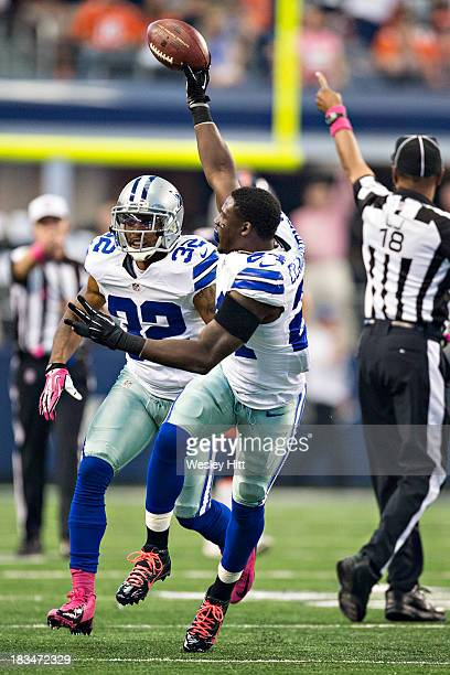 Morris Claiborne of the Dallas Cowboys celebrates after recovering a fumble against the Denver Broncos at AT&T Stadium on October 6, 2013 in...