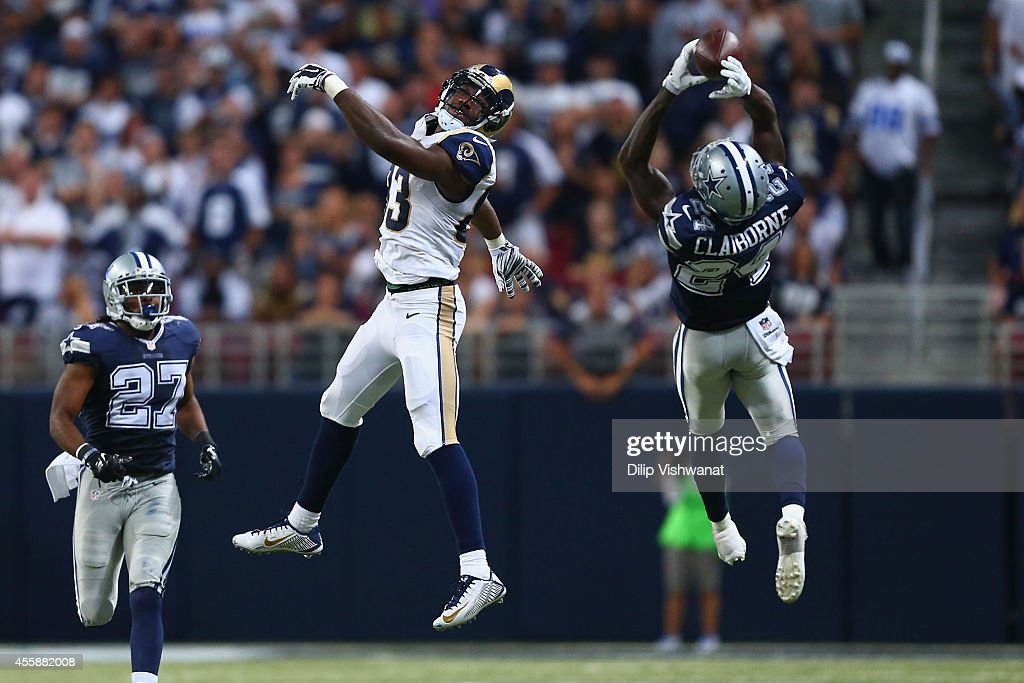Morris Claiborne #24 of the Dallas Cowboys intercepts a pass intended for Brian Quick #83 of the St. Louis Rams in the fourth quarter at the Edward Jones Dome on September 21, 2014 in St. Louis, Missouri. The Cowboys beat the Rams 34-31.