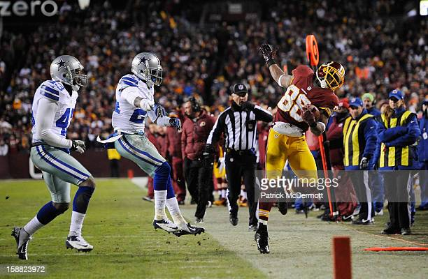Morris Claiborne of the Dallas Cowboys pushes Pierre Garcon of the Washington Redskins out of bounds after Garcon caught a pass in the third quarter...