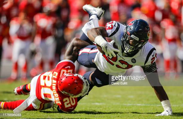 Morris Claiborne of the Kansas City Chiefs tackles Carlos Hyde of the Houston Texans in the second quarter at Arrowhead Stadium on October 13, 2019...
