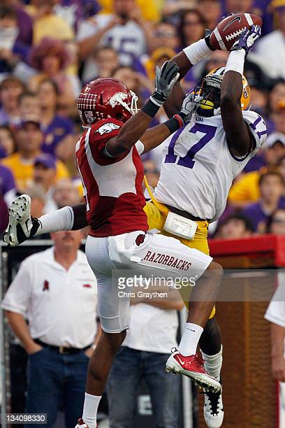 Morris Claiborne of the Louisiana State University Tigers catches an interception intended for Jarius Wright of the Arkansas Razorbacks at Tiger...