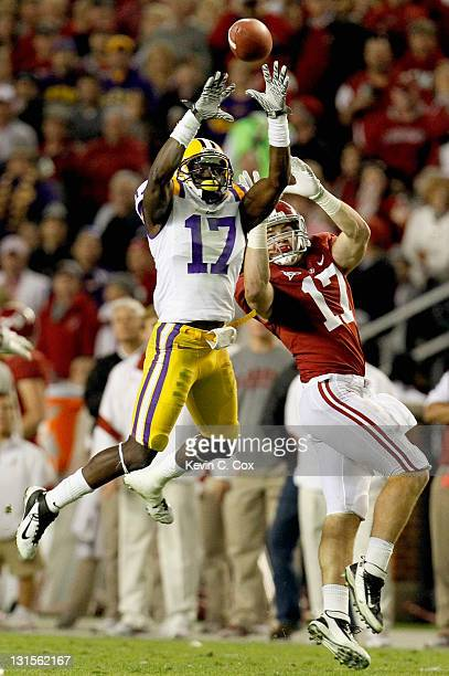 Morris Claiborne of the LSU Tigers makes an interception over Brad Smelley of the Alabama Crimson Tide during the second half of the game at...