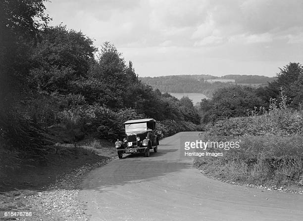 Morris Cowley Tourer taking part in a First Aid Nursing Yeomanry trial or rally, 1931. Morris Cowley Tourer 1930 1548 cc. Vehicle Reg. No. UP4673....