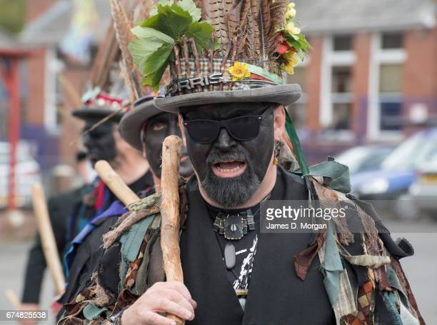 Morris dancer with his face painted black as part of a traditional disguise attends the Green Man Spring Festival on April 29 2017 in Bovey Tracey...