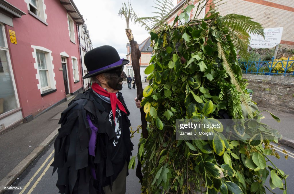 A Morris dancer with his face painted black as part of a traditional disguise looks at a man dressed in a tree foilage costume at the Green Man Spring Festival on April 29, 2017 in Bovey Tracey, England. Dozens of morris dancers were watched by hundreds of locals and tourists in the annual event held over the May Bank Holiday weekend. Morris dancing is a form of English folk dance, with participants wearing bell pads on their shins and holding implements such as sticks and handkerchiefs. Additionally make up is worn to complete the festivities.