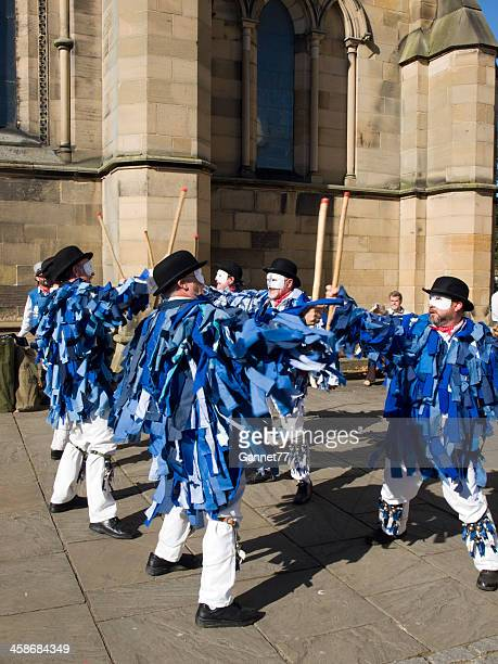 morris dancers outside hexham abbey, northumberland, england. - morris dancing stock photos and pictures