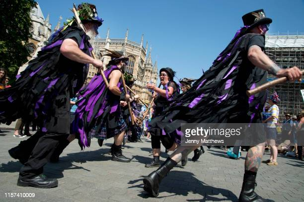 Morris dancers protest outside th Houses of Parliament at May 4th 2020 being designated VE day celebration instead of being the May Day holiday on...