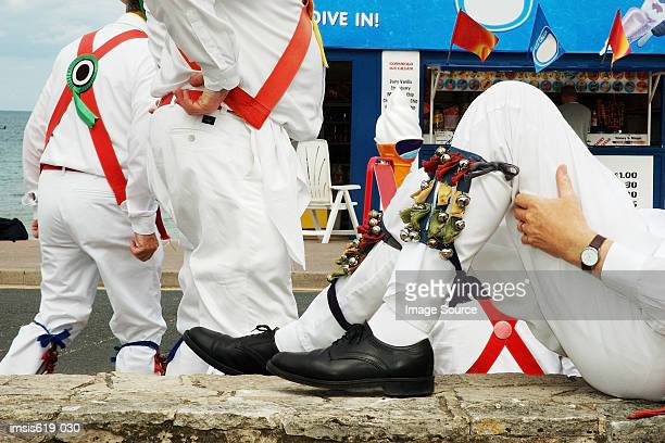 morris dancers relaxing - morris dancing stock photos and pictures