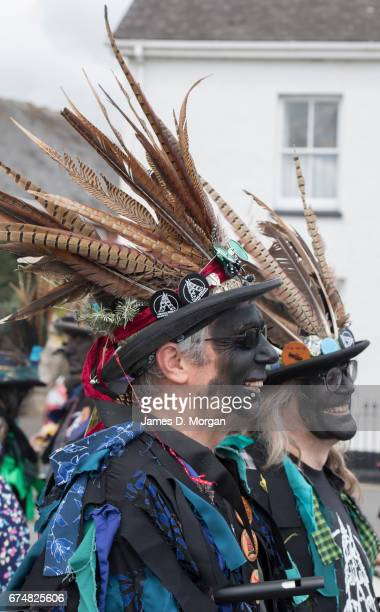 Morris dancers with their faces painted black as part of a traditional disguise attend the Green Man Spring Festival on April 29 2017 in Bovey Tracey...