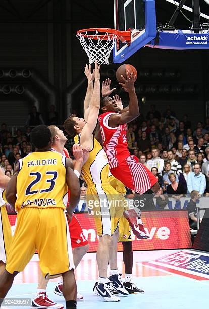 Morris Finley #10 of Armani Jeans Milano competes with Jasmin Perkovic #12 of EWE Basket Oldenburg during the Euroleague Basketball Regular Season...