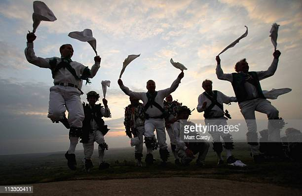Morris Men dance at a May Day dawn celebration service in front of St Michael's Tower on Glastonbury Tor on May 1 2011 in Glastonbury England...