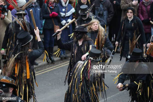Morris Molly and traditional folk dancers perform as The Straw Bear dances through the streets during the annual Whittlesey Straw Bear Festival...