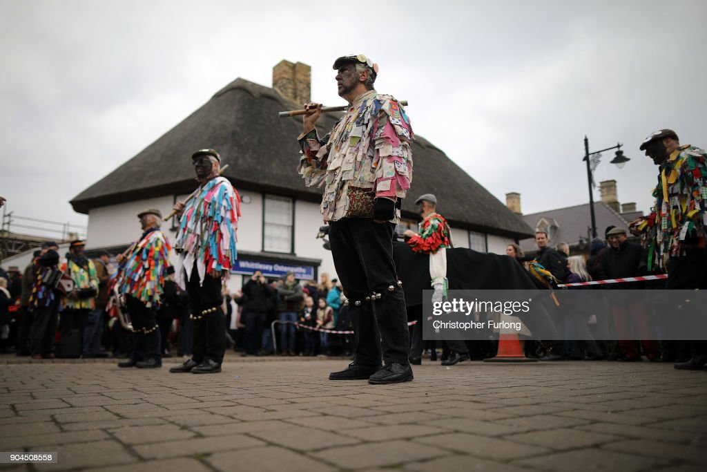 Morris, Molly and traditional folk dancers perform as The Straw Bear dances through the streets during the annual Whittlesey Straw Bear Festival parade on January 13, 2018 in Whittlesey, United Kingdom. The traditional event was revived in 1980 and features a 'Straw Bear' and it's children being led through the streets of the English village of Whittlesey, near Peterborough, United Kingdom. The bear dances, while musicians break off into groups around the village square to perform with many different Morris, Molly, Sword, Mummer and Appalachian dancing teams.