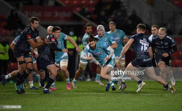 Morris Oli of Worcester is tackled by Sam Hill of Sale during the Gallagher Premiership Rugby match between Sale Sharks and Worcester Warriors at AJ...