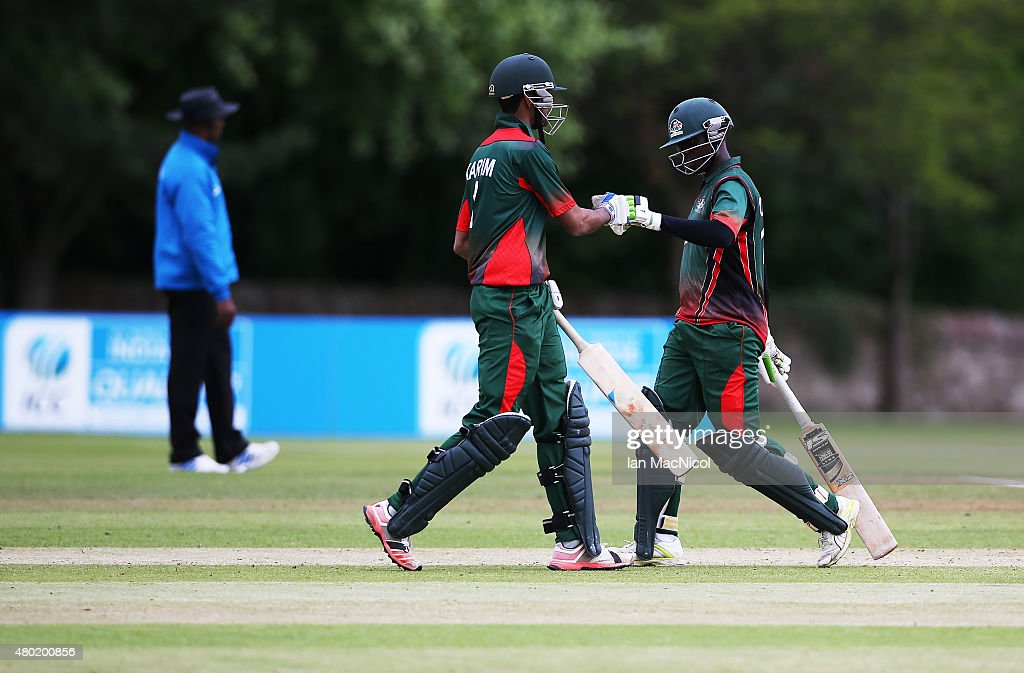 Morris Ouma and Irfan Karmin of Kenya celebrate victory during the ICC World Twenty20 India Qualifier between Canada and Kenya at Myreside Cricket Club, on July 10, 2015 in Edinburgh Scotland.