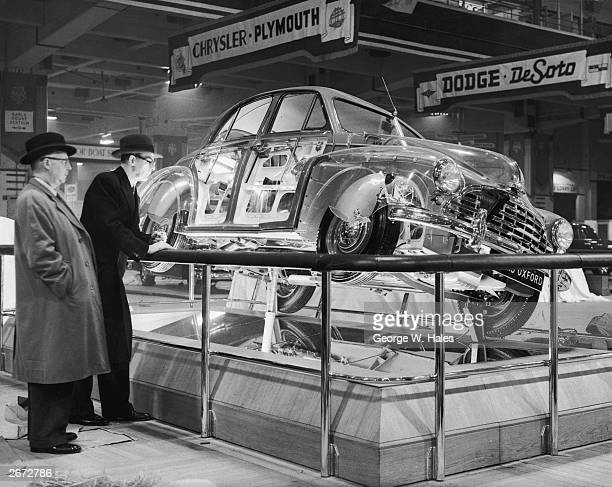 A Morris Oxford saloon car finished in perspex to permit visitors to examine the interior fittings and mechanism at the 36th International Motor Show...