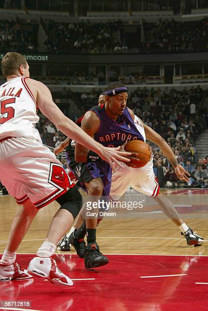 Morris Peterson of the Toronto Raptors drives to the basket against Darius Songaila of the Chicago Bulls during the game at the United Center on...