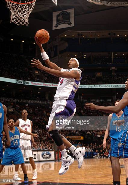Morris Peterson of the Toronto Raptors glides inside for the open layup against the Orlando Magic on March 9 2005 at the Air Canada Centre in Toronto...
