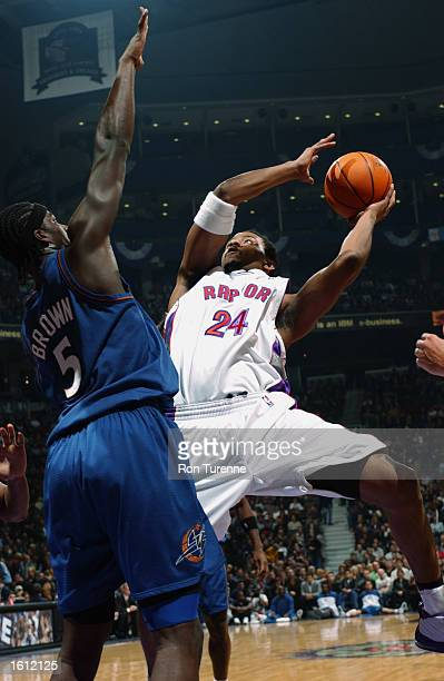 Morris Peterson of the Toronto Raptors goes for the shot over Kwame Brown of the Washington Wizards during the game at Air Canada Centre on October...