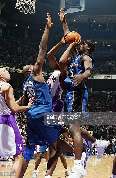 Morris Peterson of the Toronto Raptors is trapped by Brendan Haywood and Kwame Brown of the Washington Wizards during the NBA game at Air Canada...