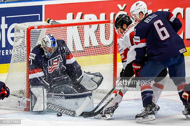 Morris Trachsler of Switzerland tries to score against Connor Hellybuyck goalkeeper of USA during the IIHF World Championship quaterfinal match...