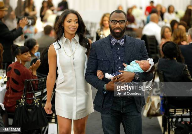 Morrisa Jenkins and Malcolm Jenkins walk the runway at the Saks Fifth Avenue And Off The Field Players' Wives Association Charitable Fashion Show on...