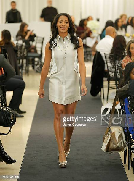 Morrisa Jenkins walks the runway at the Saks Fifth Avenue And Off The Field Players' Wives Association Charitable Fashion Show on January 31 2014 in...