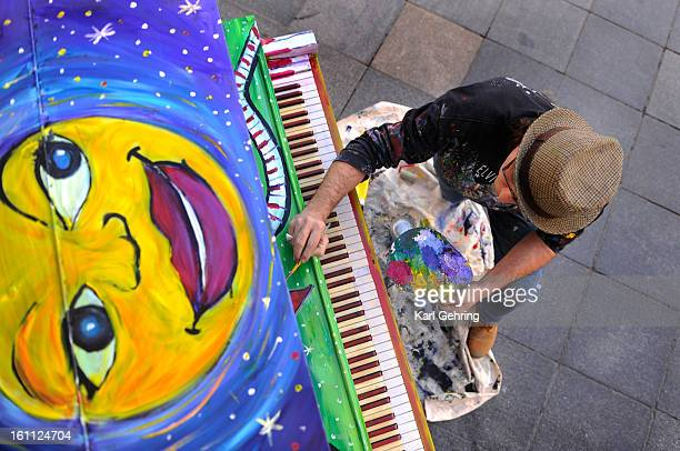 Morrison artist Keith Scramble Campbell painted the first of ten pianos that the Downtown Denver Partnership is placing on the 16th Street Mall for...