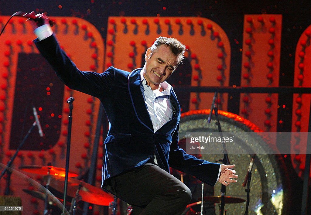 Morrissey performs on stage on the second day of 'The Carling Weekend: Reading Festival' on August 28, 2004 in Reading, England. The festival takes place at two venues simultaneously with the second site at Bramhall Park, Leeds.