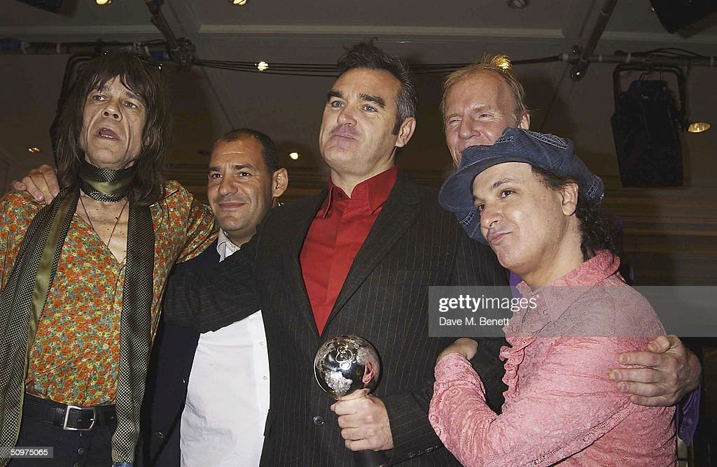 Morrissey poses with his O2 Silver Clef Award with presenters the New York Dolls at the Nordoff-Robbins O2 Silver Clef Awards at the Inter-Continental Hotel on June 18, 2004 in London.