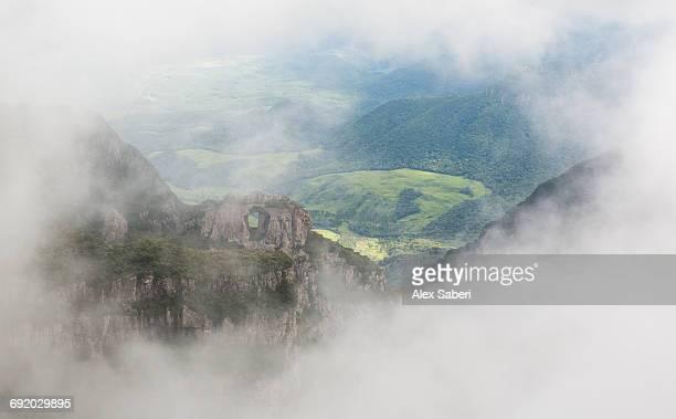 morro da igreja rock in the cloud and mist near urubici, santa catarina, brazil. - alex saberi stock pictures, royalty-free photos & images