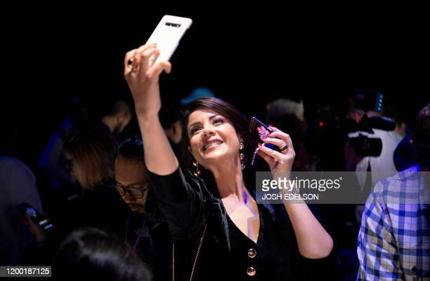 Morrocan actressmodel Leila Hadioui takes a selfie while holding a Samsung Galaxy Z Flip phone displayed during the Samsung Galaxy Unpacked 2020...