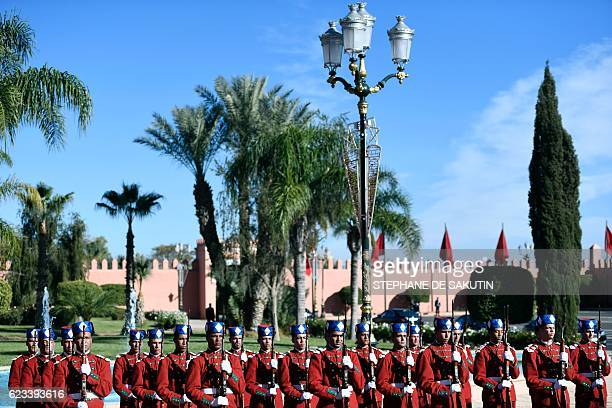 Morrocan honour guards wait for the arrival of world leaders attending an official lunch given by Morocco's King for the opening of the highlevel...